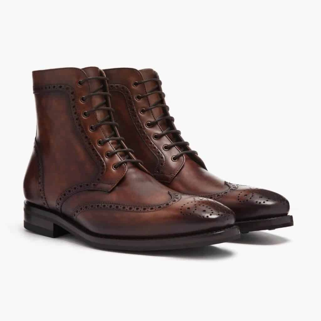 Dark brown wingtip lace-up boots.