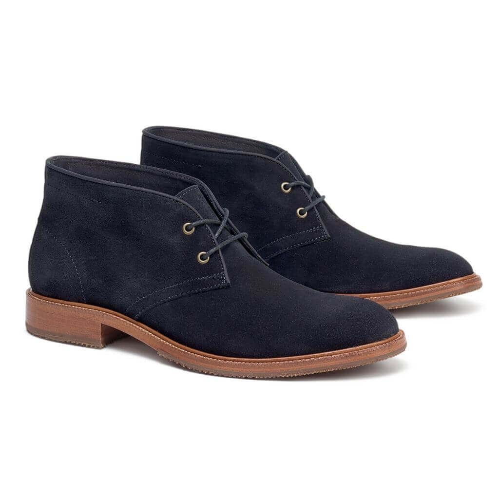 Navy blue suede Chukka boots.