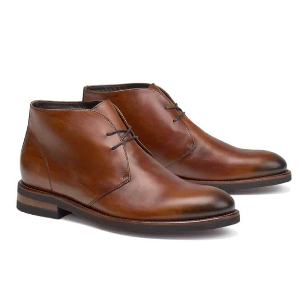 Brown leather Chukka boots.