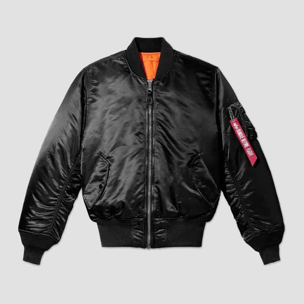 Black Alpha Industries MA-1 bomber jacket with an orange interior lining.