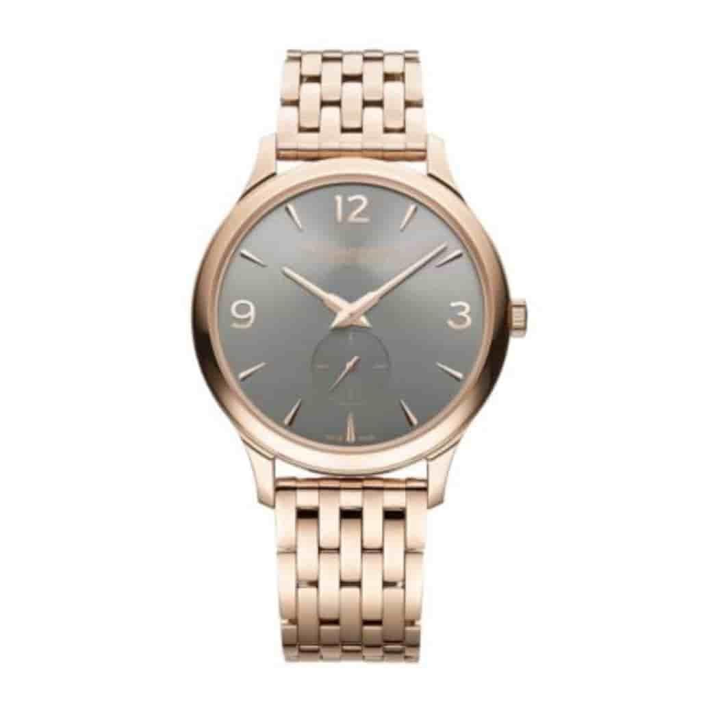 Chopard L.U.C. watch with a rose gold metal strap.
