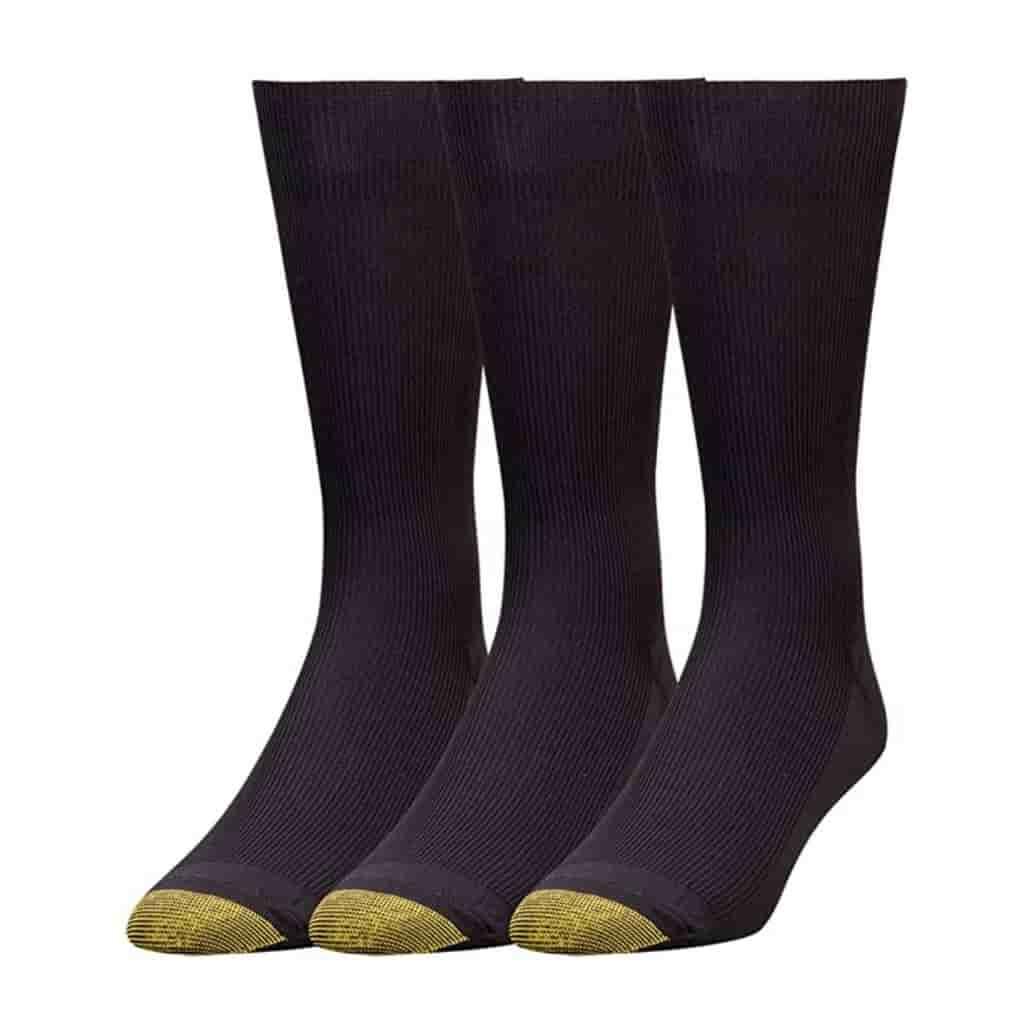 Three black dress socks with gold toes.