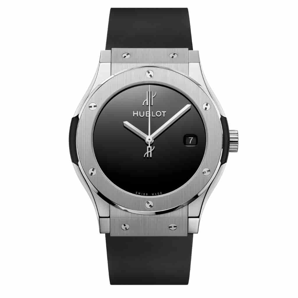 Hublot Classic Fusion watch with a silver metal case and black rubber strap.