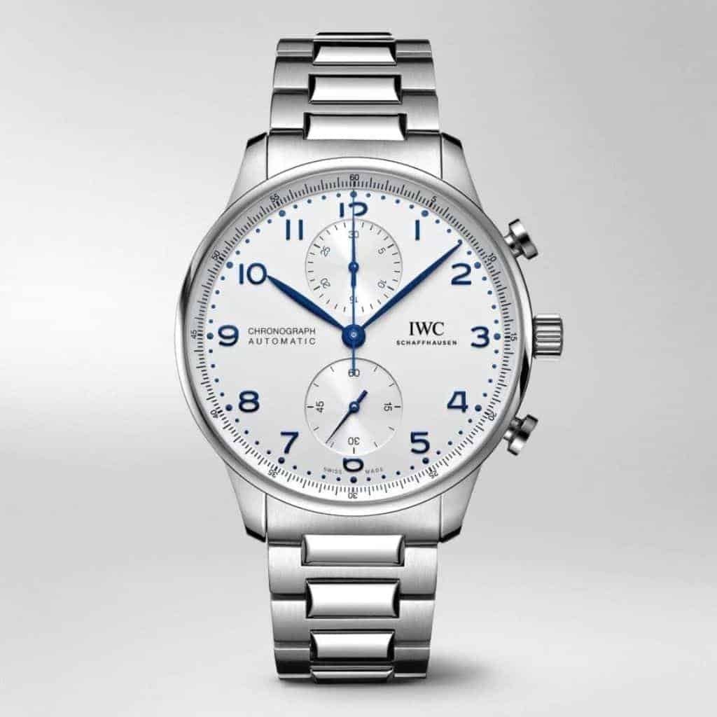 IWC Portugieser watch with blue numbers and silver metal bracelet strap.