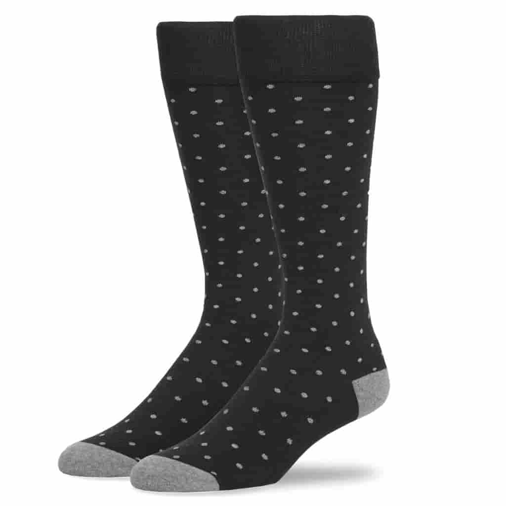 Pair of black socks with grey dots.