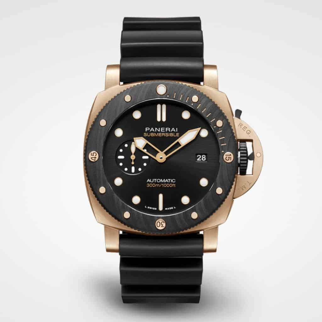 Panerai Submersible watch with a gold case and black strap.