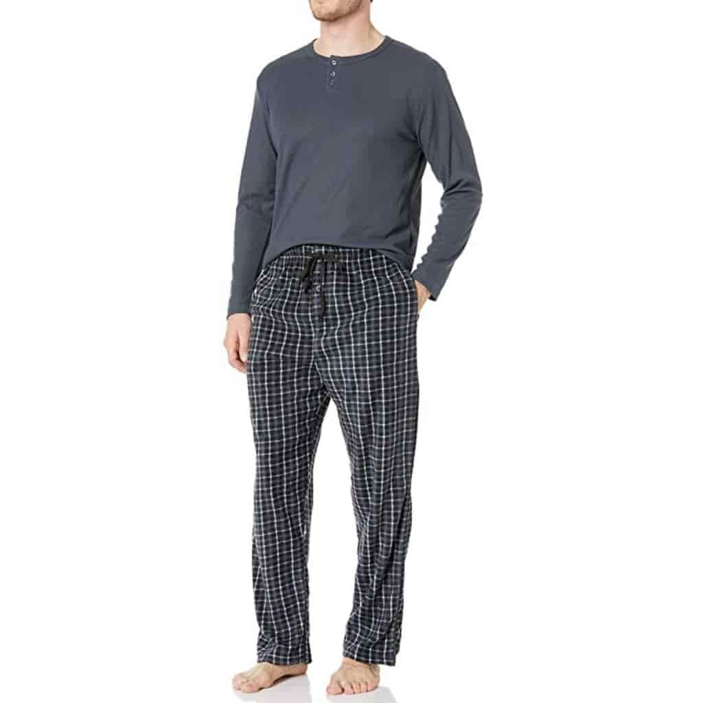 Person wearing a grey henley shirt and black plaid pajama pants.
