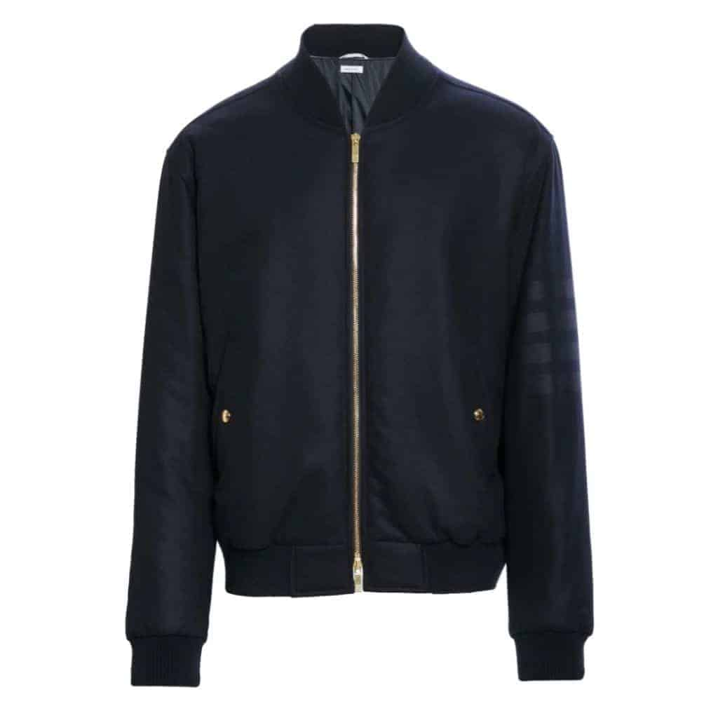 Thom Browne black bomber jacket with a gold zipper.