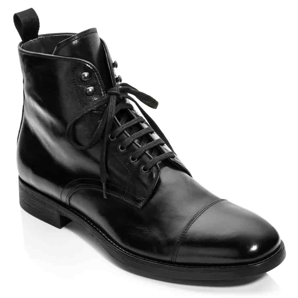 Black leather lace-up cap-toe boot.