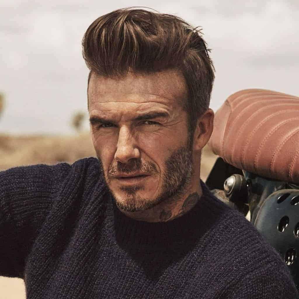 David Beckham with a pompadour haircut.
