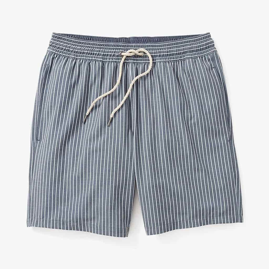 Blue swim trunks with white vertical stripes.