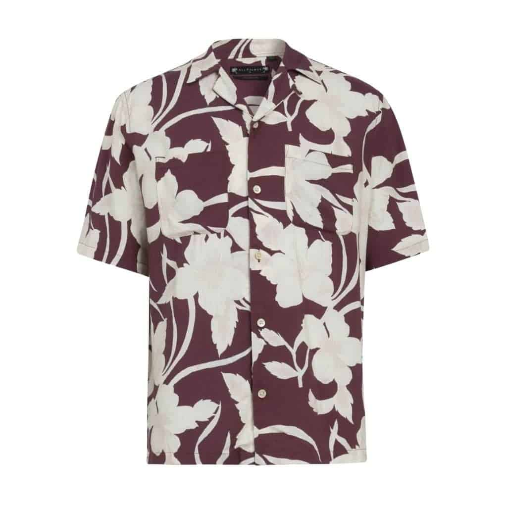 Red and white floral camp collar shirt.