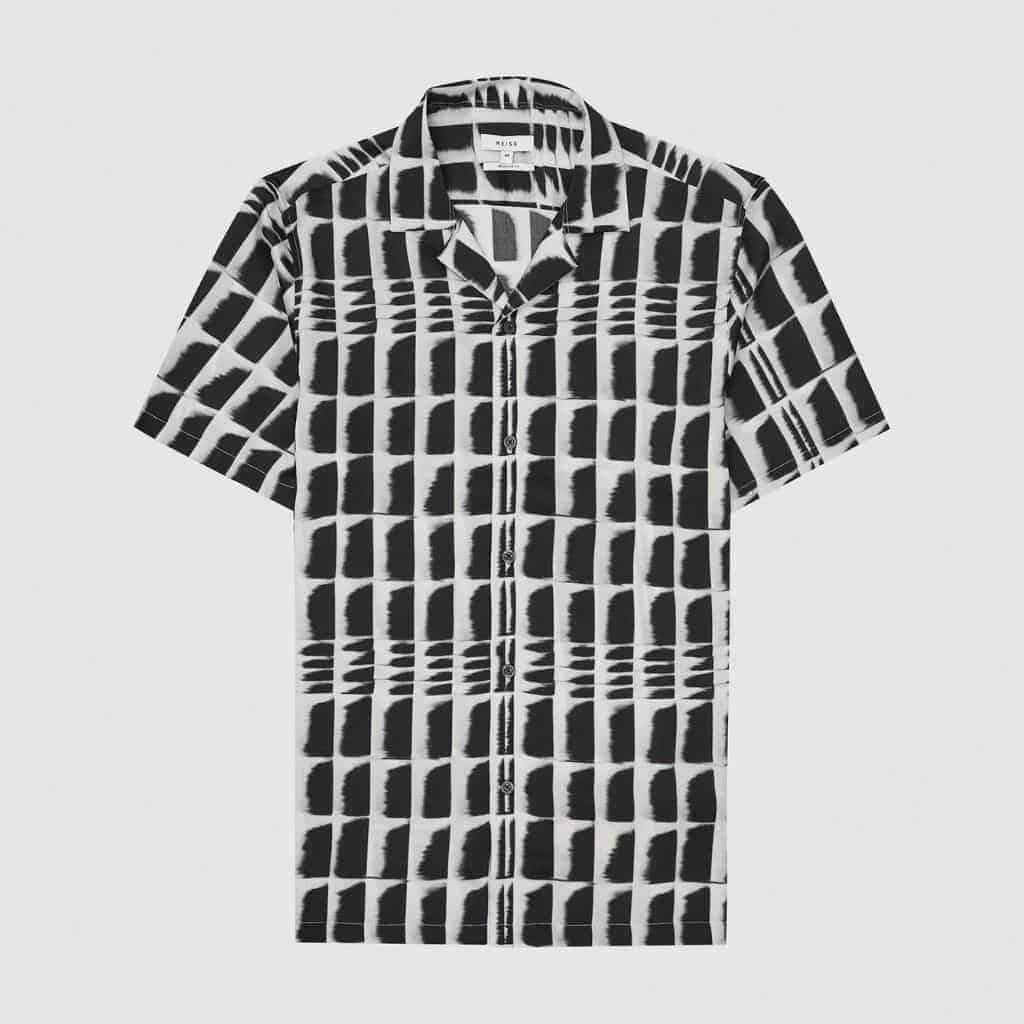 Black and white print on a camp collar shirt.