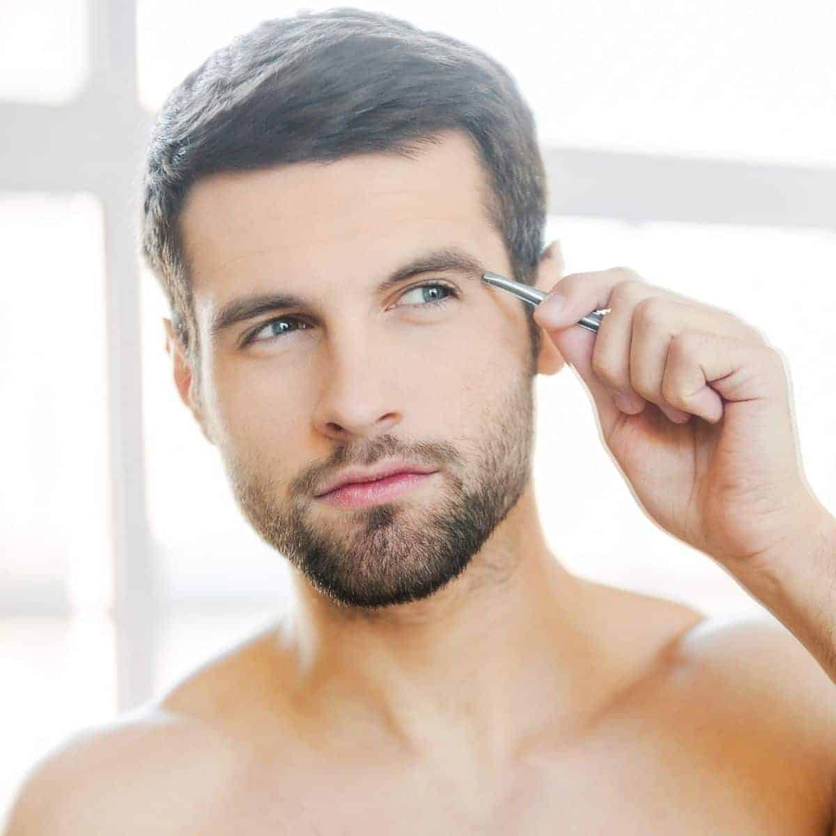Man plucking eyebrow.