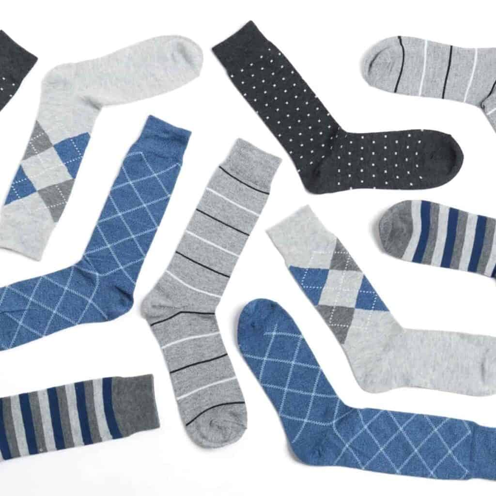 Flatlay of men's dress socks with different patterns.