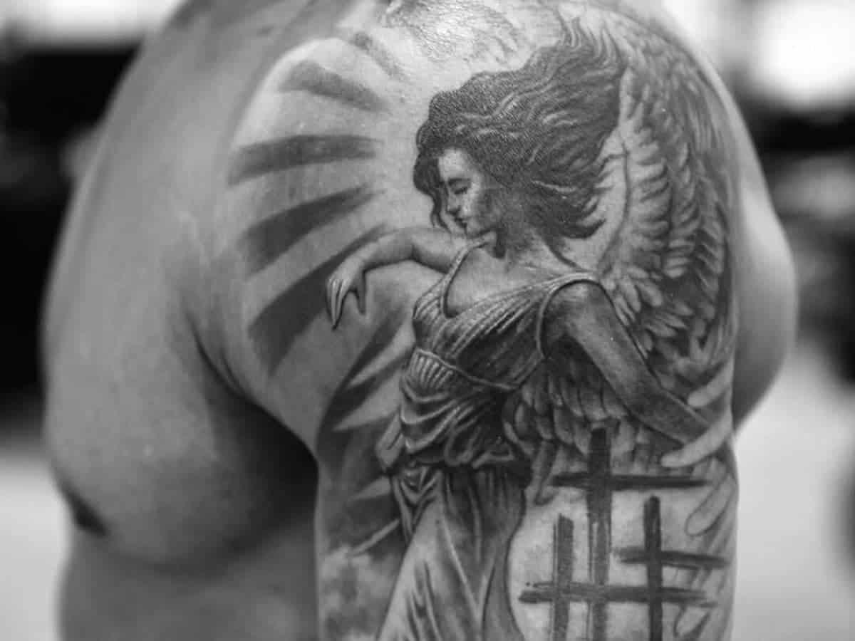 Angel shoulder tattoo.