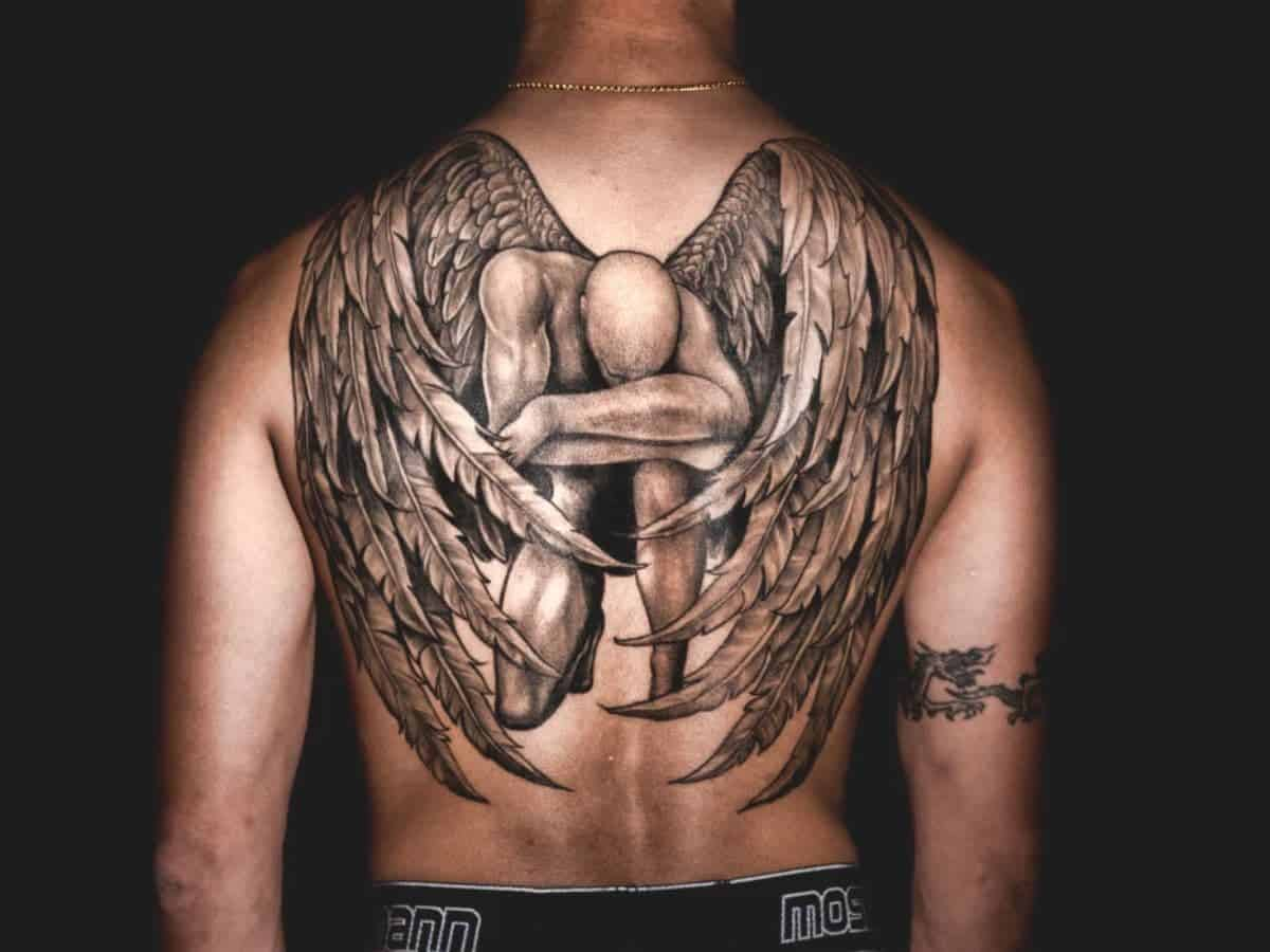 Large angel tattoo on a person's back.