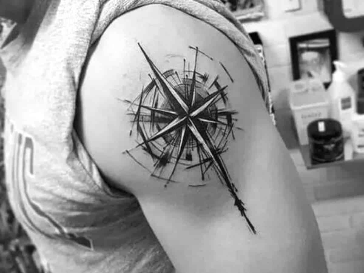 Compass tattoo on a person's shoulder.