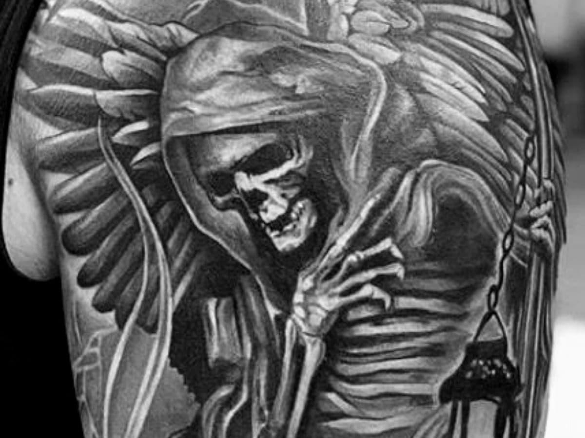 Grim Reaper shoulder tattoo.
