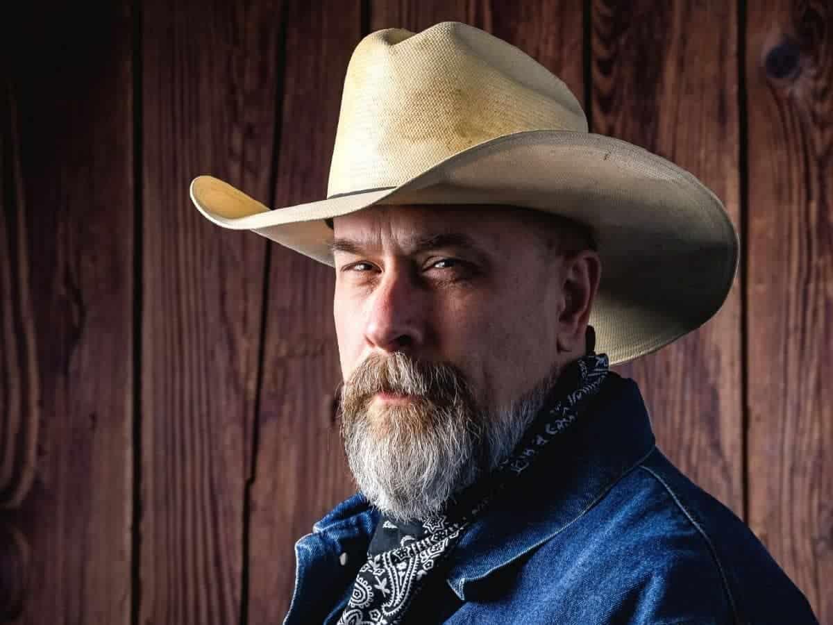 Headshot of a cowboy.