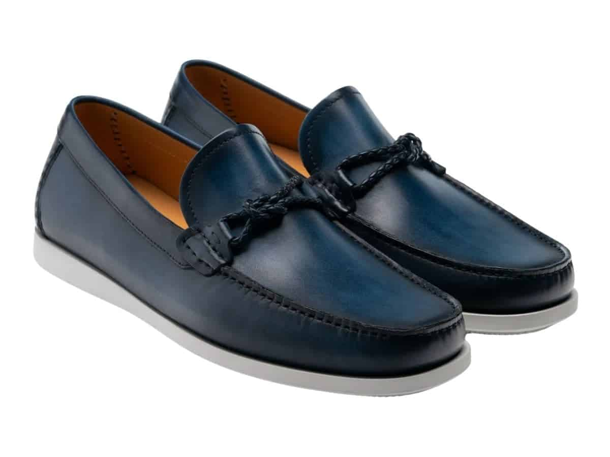 Pair of navy leather driving shoes.