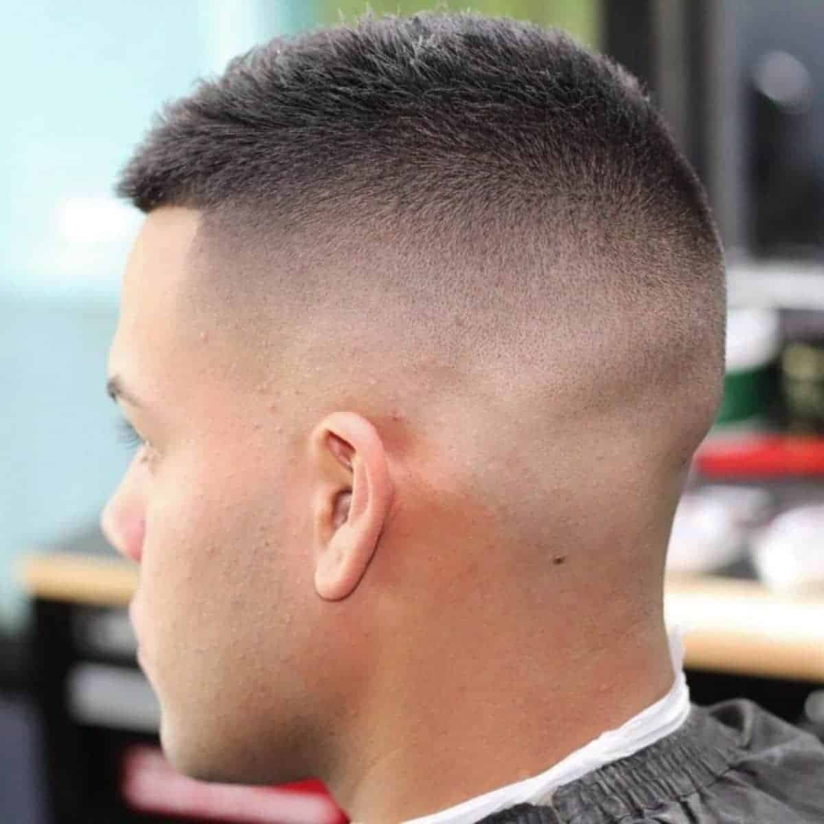 Person with a high fade buzzcut.
