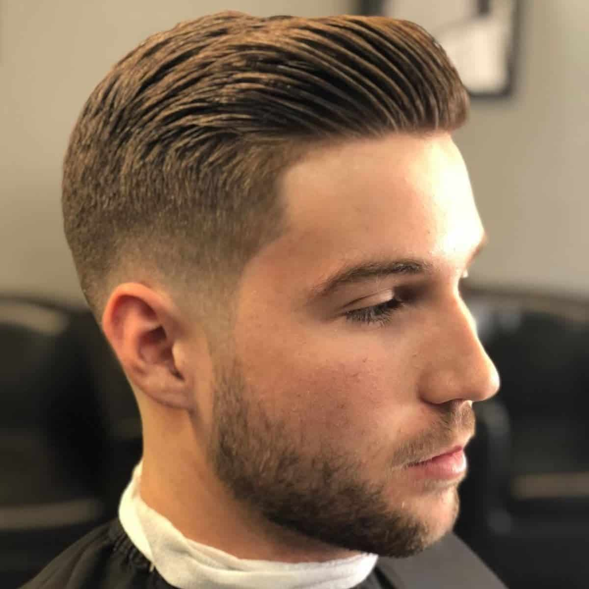 Person with a low fade haircut.