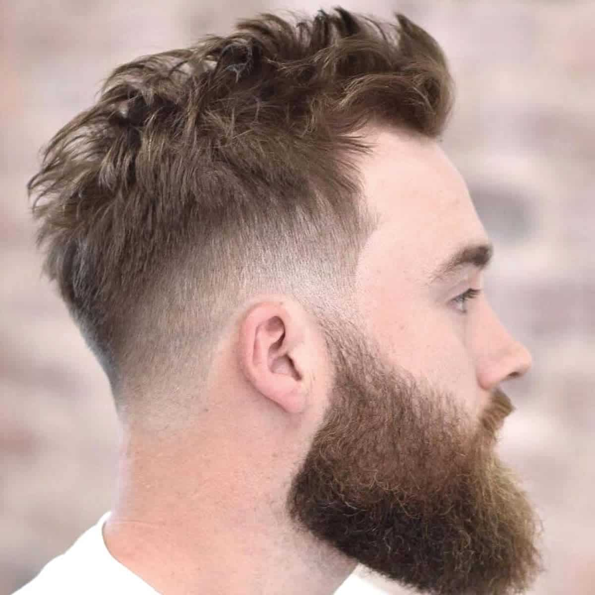 Person with a mid-fade haircut.