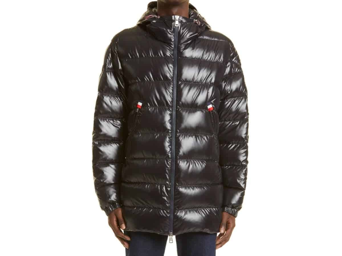 Person wearing a Moncler down puffer jacket.