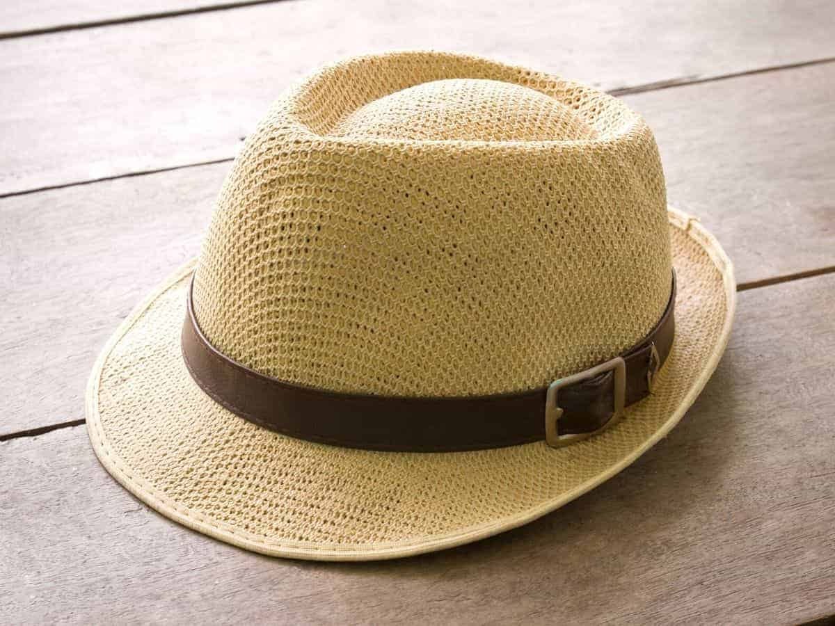 Panama hat on a wooden table.