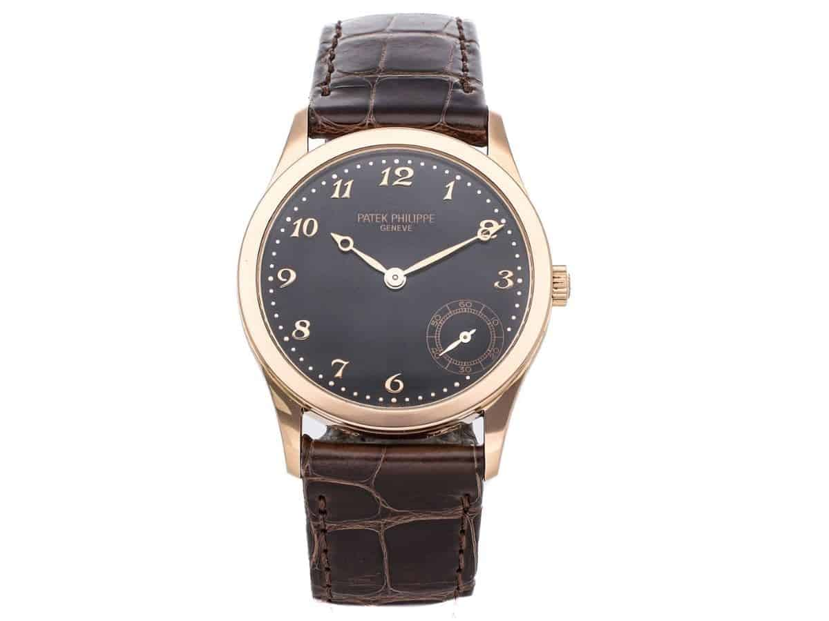 Patek Philippe Calatrava watch with a brown leather strap.