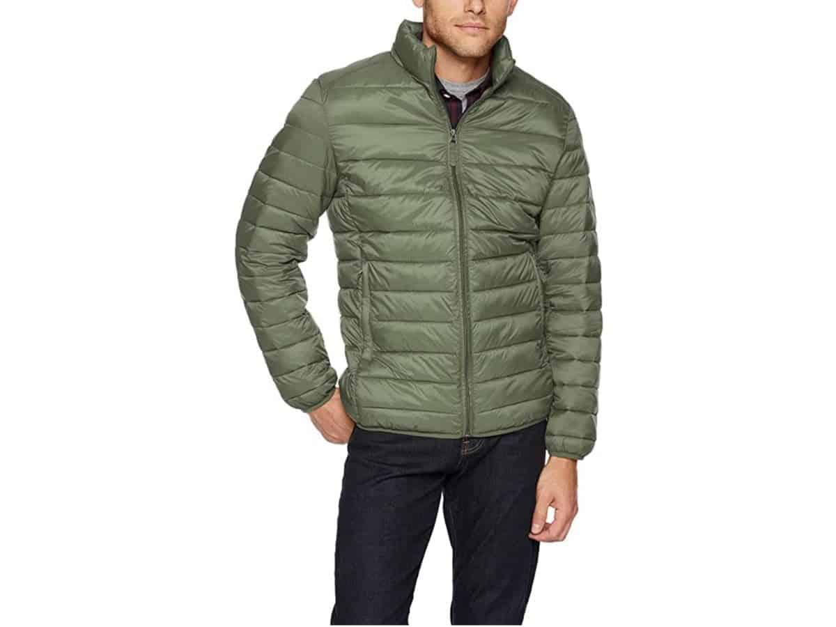 Person wearing an Amazon puffer jacket with jeans.