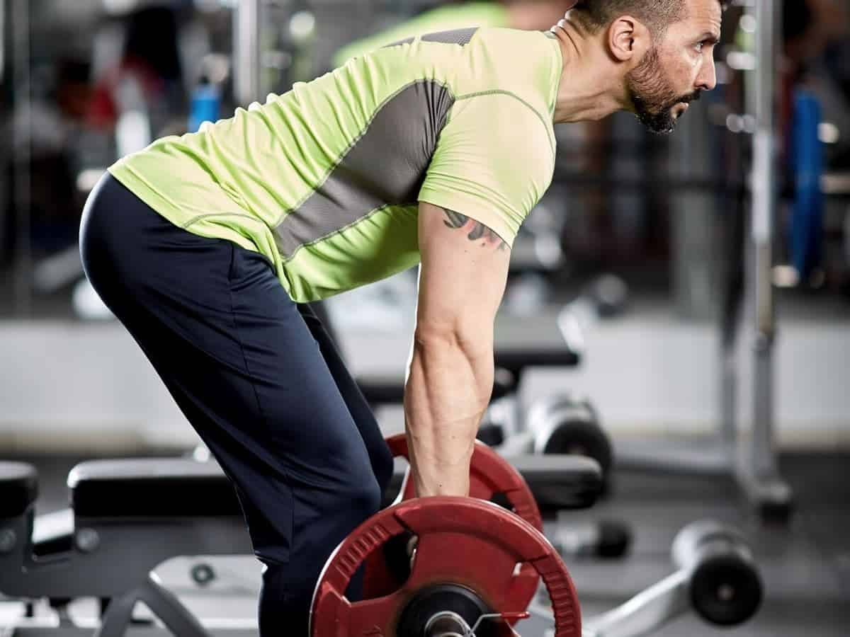 Person doing a barbell bent-over row.