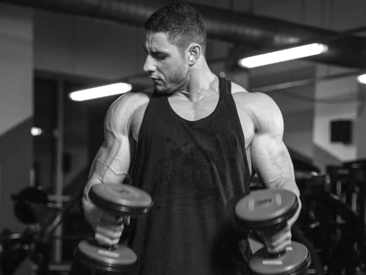 Person doing dumbbell hammer curls.