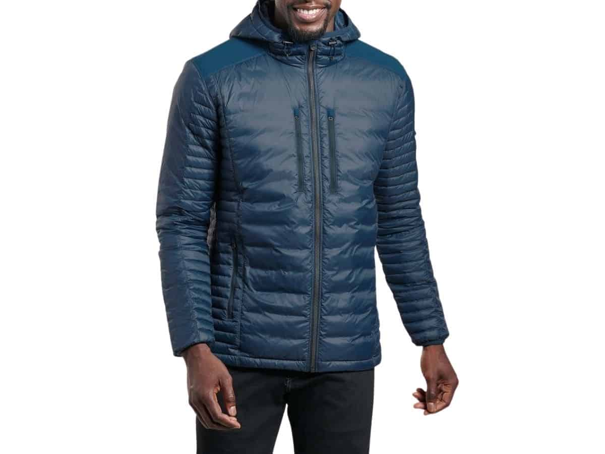 Person wearing a hooded puffer jacket and jeans.