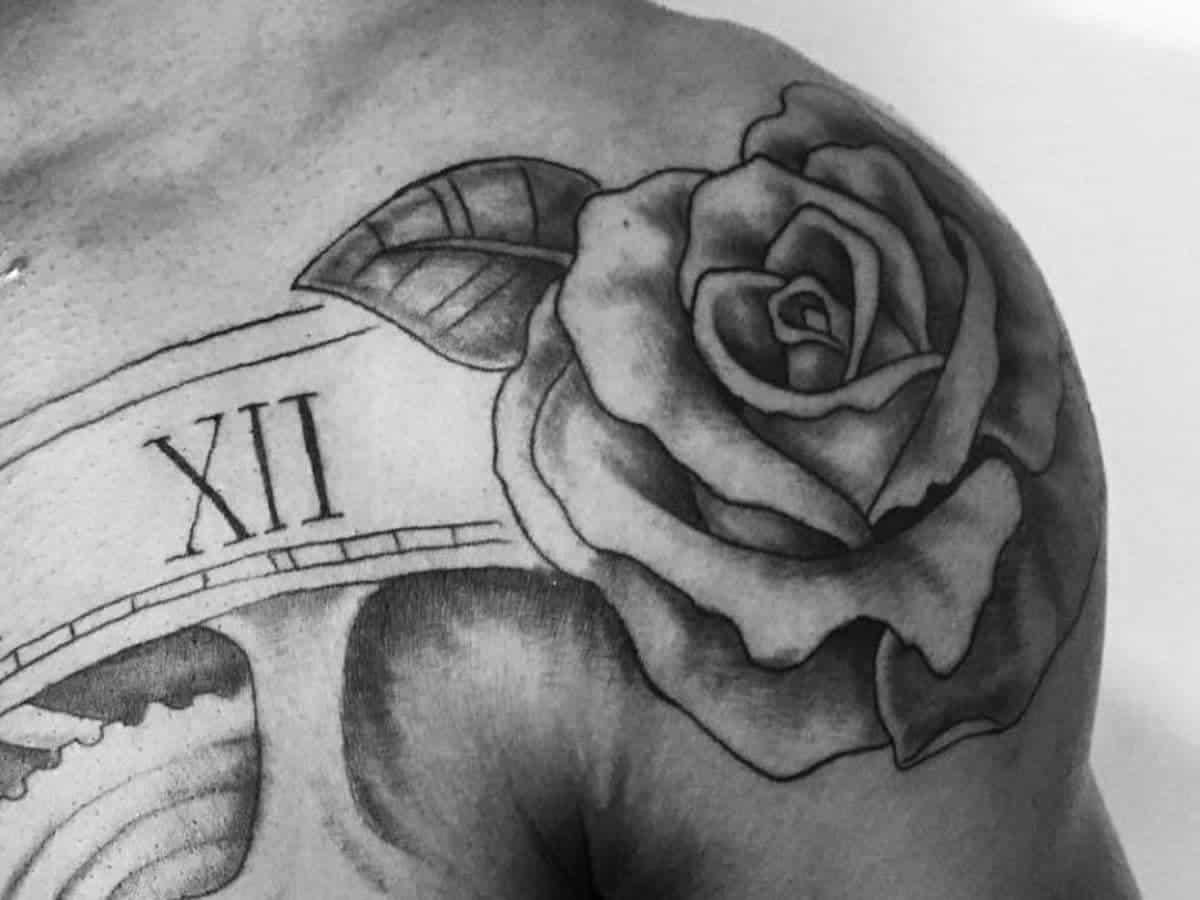 Rose shoulder tattoo.