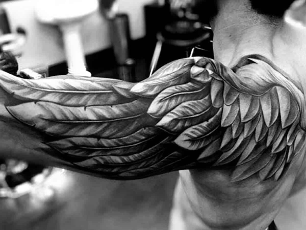 Wing tattoo on a person's shoulder.