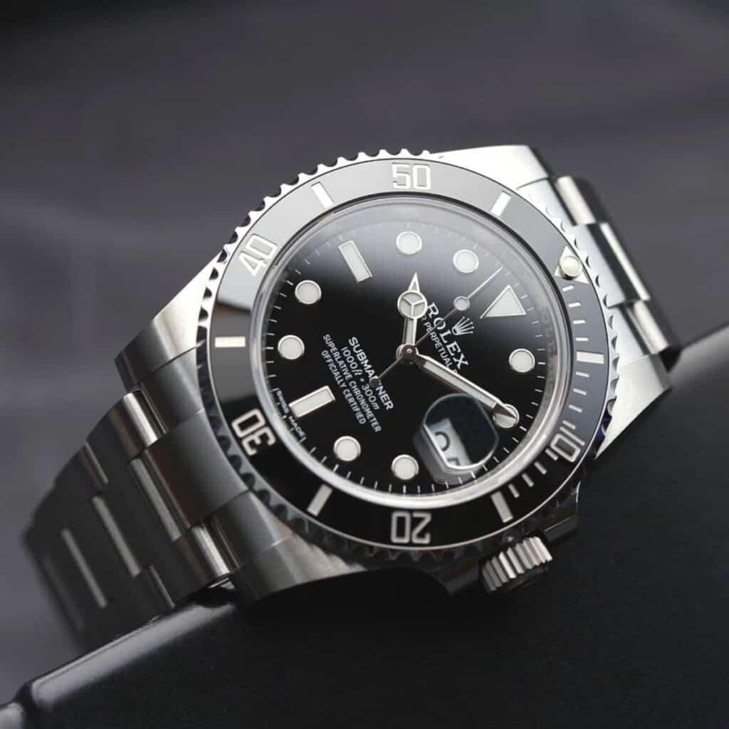 Silver Rolex watch.