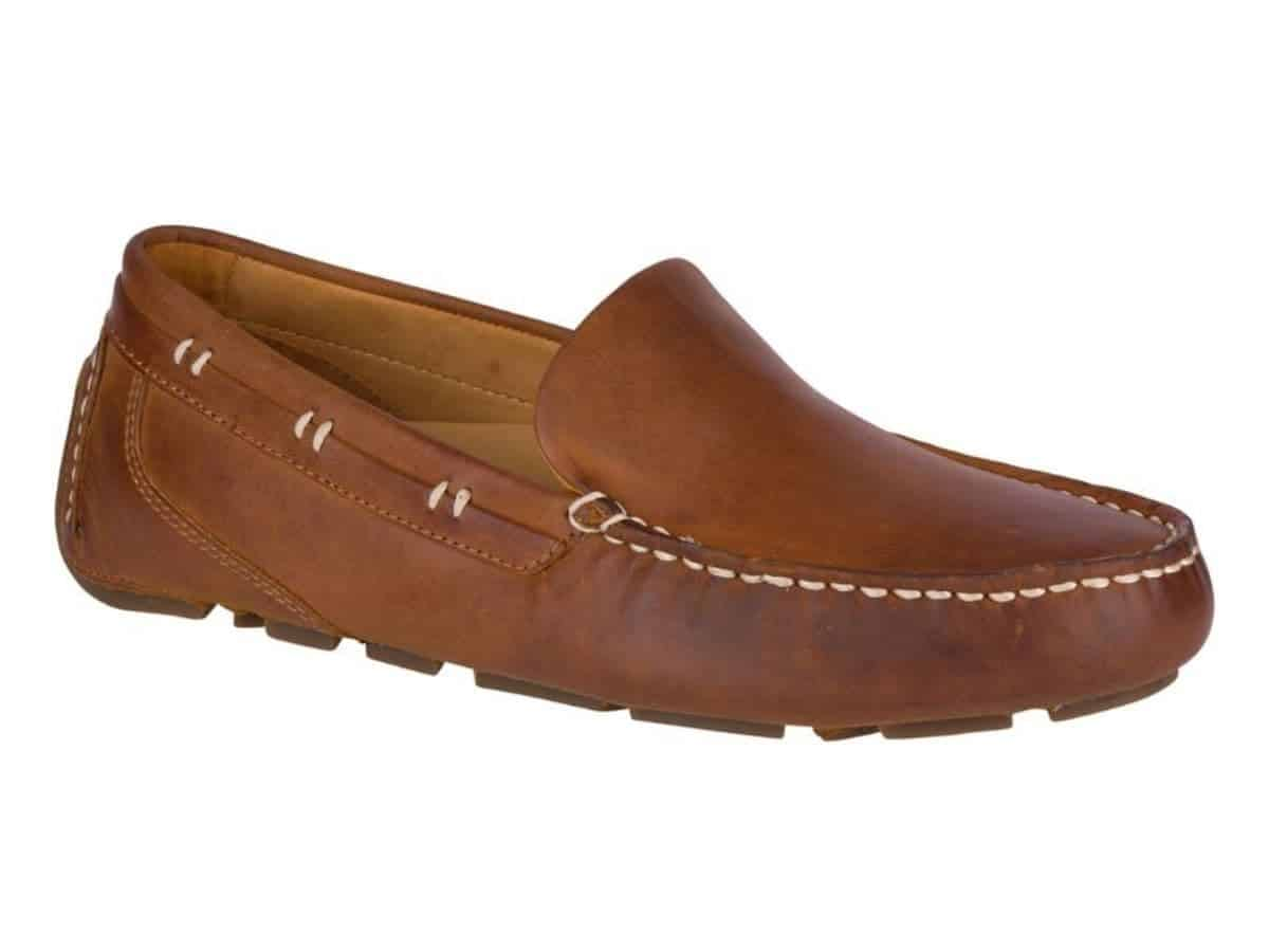 Side of a Sperry brown leather driving shoe.