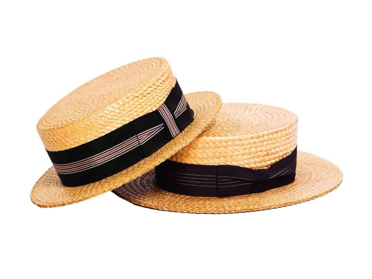 Two boater hats stacked.